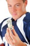 Fußball: Spieler, der Rolle des Bargeldes betrachtet Stockbilder