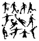 Fußball-Spieler-Schattenbilder Stockfoto