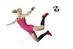 Fußball tritt innen mitten in der Luft Lizenzfreie Stockfotos