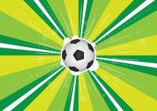 Fußball und grüne Hintergrundexplosion Stockbild