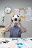 Fußballfan am Arbeitsplatz Stockfotos