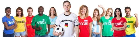Fußballfan aus Deutschland mit Fans aus anderen Ländern Stockbild