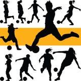 Fußballfrauenschattenbild Mädchenspielfußball Lizenzfreies Stockfoto