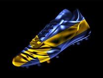 Fußballfußballstiefel mit der Flagge von Schweden druckte auf ihm stock abbildung
