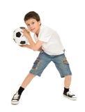 Fußballjungenstudio lokalisiert Lizenzfreie Stockfotos