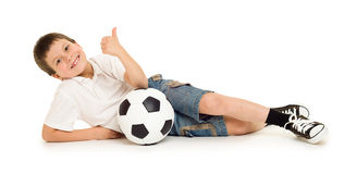 Fußballjungenstudio lokalisiert Stockfotografie