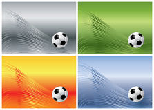 Fußballkugel auf abstrakten Hintergründen Stockfotografie