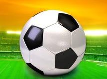 Fußballkugel auf dem Feld Lizenzfreie Stockbilder