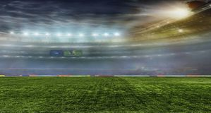 Fußballkugel auf dem Feld des Stadions Stockfotos