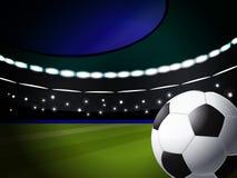 Fußballkugel auf dem Stadion Stockbild