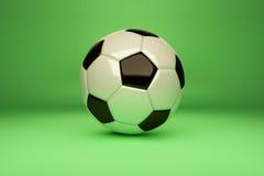 Fußballkugel auf grünem Hintergrund Stockbild