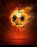 Fußballkugel und -feuer Stockfotos