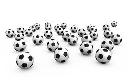 Fußballkugeln über weißem Hintergrund Lizenzfreie Stockfotografie