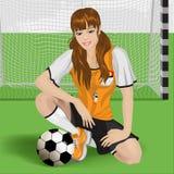 Fußballmädchensitzen Stockfoto