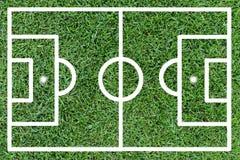 Fußballplatz auf grünem Gras Stockfotografie
