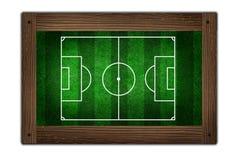 Fußballplatz auf Holzrahmen Stockbild