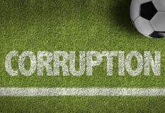 Fußballplatz mit dem Text: Korruption Stockbilder