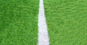 Fußballplatzhintergrund des grünen Grases, Draufsicht der Nahaufnahme lizenzfreies stockfoto