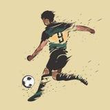 Fußballschießen-Tintenspritzen Stockfoto