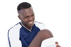 Fußballspieler in den Schmerz Stockfoto