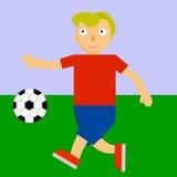 Fußballspieler, der Fußball auf einem Spielplatz spielt Stockfoto