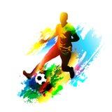 Fußballspieler, der mit dem Ball läuft Lizenzfreie Stockfotografie