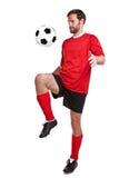 Fußballspieler herausgeschnitten auf Weiß Lizenzfreies Stockbild