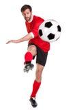 Fußballspieler herausgeschnitten auf Weiß Lizenzfreies Stockfoto
