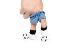 Fußballspieler mit zwei Bällen Stockfoto