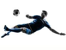 Fußballspielermann, der das Schattenbild lokalisiert tritt Stockbild