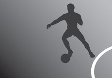 Fußballspielerschattenbild Lizenzfreie Stockfotografie