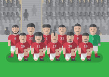 Fußballteam vor flachem grafischem Knie des Matches an lizenzfreies stockfoto