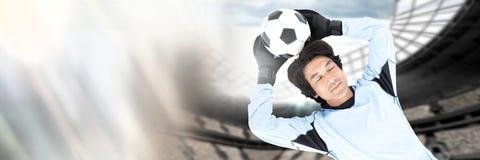 Fußballtorhüter-Einsparungsball im Ziel mit Übergang lizenzfreies stockbild