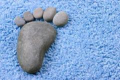 Fußsymbol auf Frotteestoff Stockbild