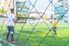 Fu?ball-Akademie f?r die Kinderausbildung verwischt f?r Hintergrund lizenzfreie stockbilder