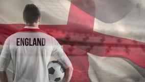 Fu?ballspieler gegen englischen Flaggenhintergrund lizenzfreie abbildung