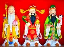 Fu lu shou statue on the wall Stock Photos