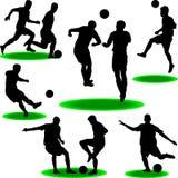 Fußballspieler-Schattenbildvektor Stockfotos