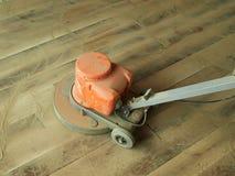 Fußbodenversanden Stockfoto