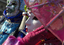 Fuchsia and blue carnival masks in Venice Royalty Free Stock Image