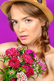Fuchsia color. Breath of summer. Romantic girl in a straw hat holds a bouquet of flowers. Beauty, summer fashion royalty free stock image