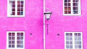 Fuchsia color wall, street lantern and four windows. 16:9. Fuchsia color wall, street lantern and four white windows. 16:9 royalty free stock image