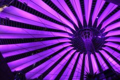 Fuchsia colored illumination of Sony center roof at night. Fuchsia colored illumination of Sony center roof by night Royalty Free Stock Image