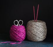 Fuchsia and grey tweed yarn on the dark wooden background Stock Images