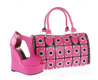 Fuchsia handbag and wedge shoe isolated on white Stock Photography