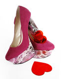 Fuchsia Heels and Red Hearts. On a white background royalty free stock photos