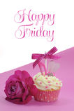 Fuchsia pink theme cupcake with shoe and heart decoration and beautiful rose, with Happy Friday. Sample text or copy space for text here stock photo