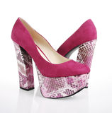 Fuchsia Shoes. Fuchsia suede shoes on a white background stock images