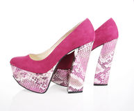 Fuchsia Shoes. Fuchsia suede shoes on a white background royalty free stock photo