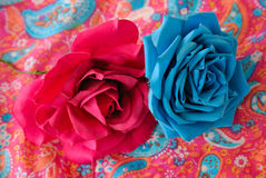 Fuchsia and turquoise roses stock photo
